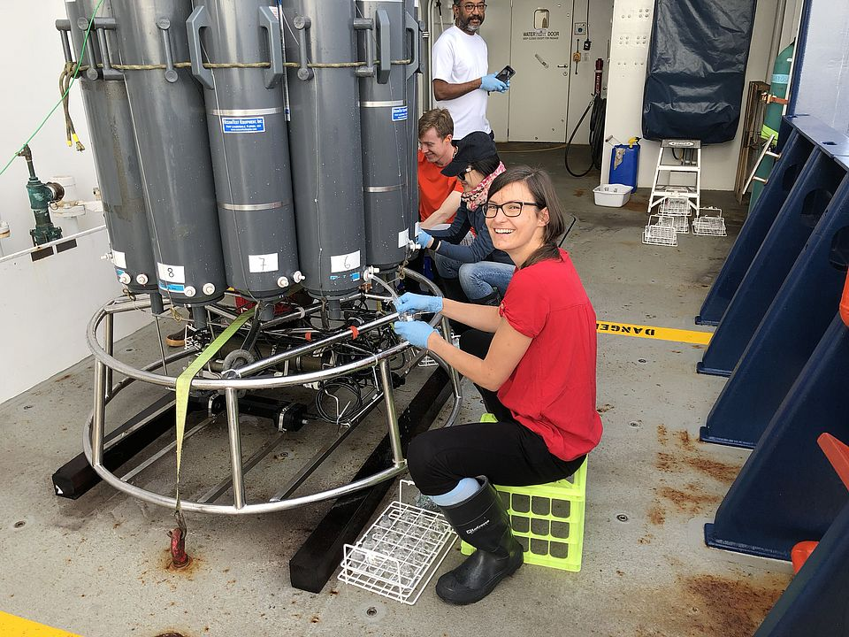 Claudia Frey collects water into serum bottles from the CTD rosette